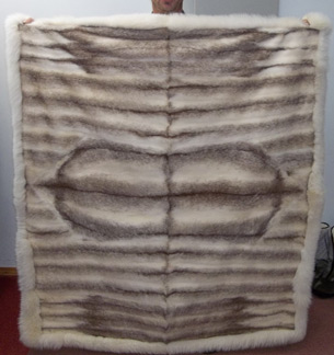 A fur blanket made from a recycled Fur Coat